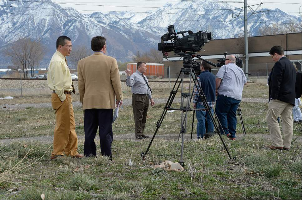 Scott Sommerdorf | The Salt Lake Tribune West Valley City councilmen Tom Huynh, left, and Steve Buhler, gesturing at center, discuss their disapproval of the choice of the site at 2249 South Winston St. (1070 W), as they were both interviewed at the site, Friday, March 10, 2017.