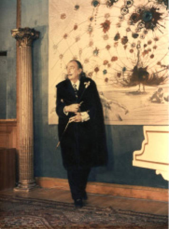 """Courtesy photo """"Dali devant tablo,"""" with Salvador Dali in foreground with Tapestry of Argus Argillet Museum,  France 1973. A special collection of Salvador Daliís artwork will be shown and available for acquisition at Old Towne Gallery in Park City on March 10-22."""