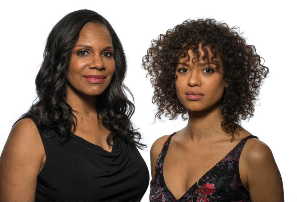 """In this March 5, 2017 photo, Audra McDonald , left, and Gugu Mbatha-Raw appear at a press junket for their film, """"""""Beauty and the Beast,"""" at the Montage Hotel in Beverly Hills, Calif. (Photo by Ron Eshel/Invision/AP)"""