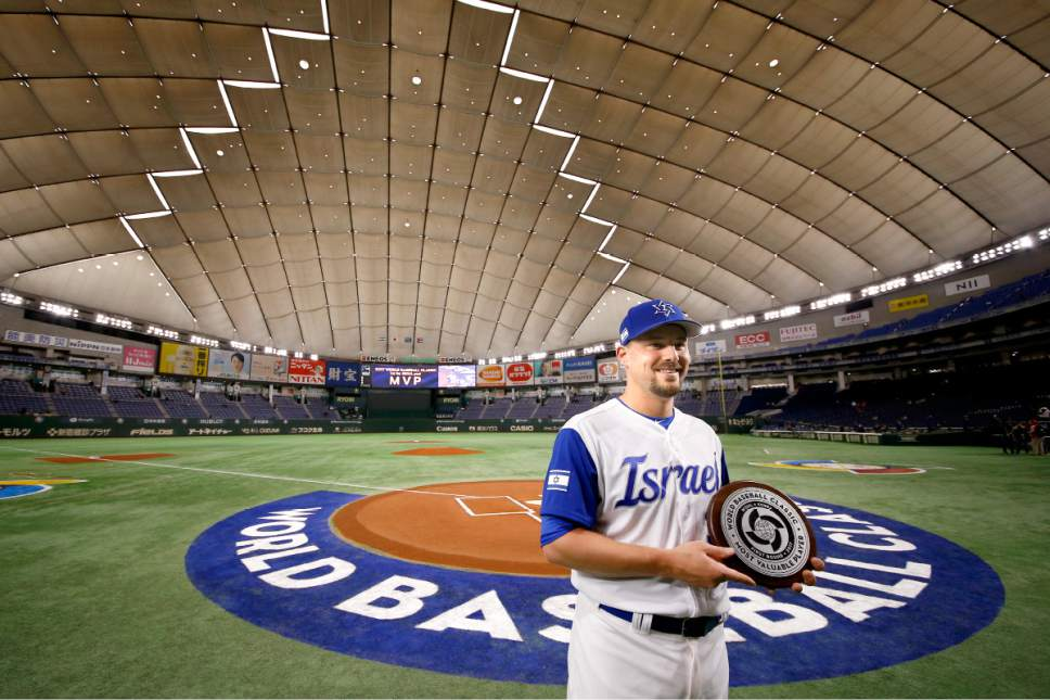 Israel's catcher Ryan Lavarnway poses with his MVP trophy of Pool A at Tokyo Dome prior to their second round game against Cuba at the World Baseball Classic in Tokyo, Sunday, March 12, 2017. (AP Photo/Shizuo Kambayashi)