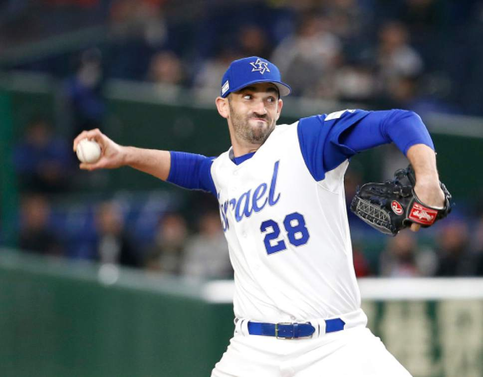 Israel's closer Josh Zeid pitches against Cuba during the ninth inning to win 4-1 at their second round game of the World Baseball Classic at Tokyo Dome in Tokyo, Sunday, March 12, 2017. (AP Photo/Toru Takahashi)