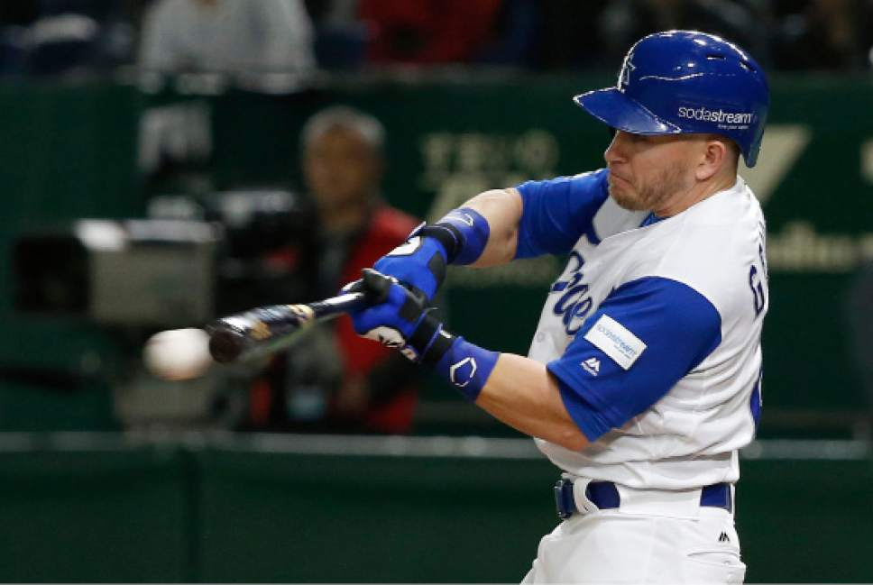 Israel's Blake Gailen hits an RBI single off Netherlands' pitcher Juan Carlos Sulbaran during the seventh inning of their second round game at the World Baseball Classic at Tokyo Dome in Tokyo, Monday, March 13, 2017. (AP Photo/Toru Takahashi)