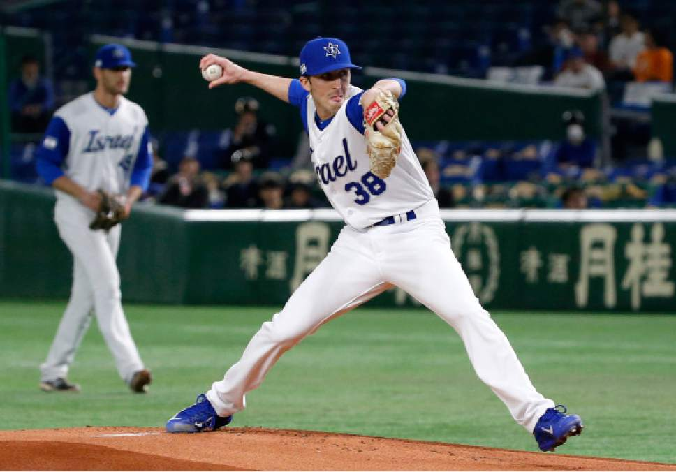 Israel's starter Corey Baker pitches against the Netherlands during the first inning of their second round game at the World Baseball Classic at Tokyo Dome in Tokyo, Monday, March 13, 2017. (AP Photo/Toru Takahashi)