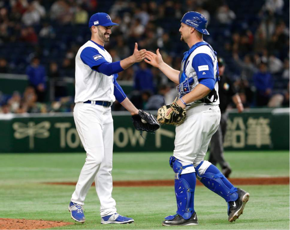 Israel's closer Josh Zeid, left, celebrates with catcher Ryan Lavarnway after beating Cuba 4-1 in their second round game of the World Baseball Classic at Tokyo Dome in Tokyo, Sunday, March 12, 2017. (AP Photo/Toru Takahashi)