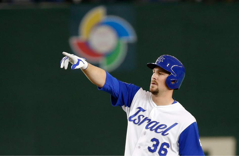 Israel's Ryan Lavarnway reacts at second after hitting a double off Cuba's starter Noelvis Entenza during the fourth inning of their second round game of the World Baseball Classic at Tokyo Dome in Tokyo, Sunday, March 12, 2017. (AP Photo/Shizuo Kambayashi)