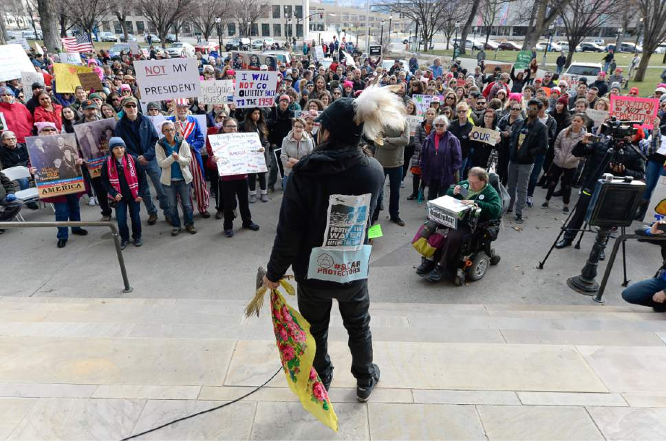 Francisco Kjolseth | The Salt Lake Tribune Carl Moore with Peaceful Advocates for Native Dialogue and Organizing Support, addresses the crowd gathered to protest President Donald Trump on President's Day in Salt Lake City, Monday, Feb. 20, 2017.