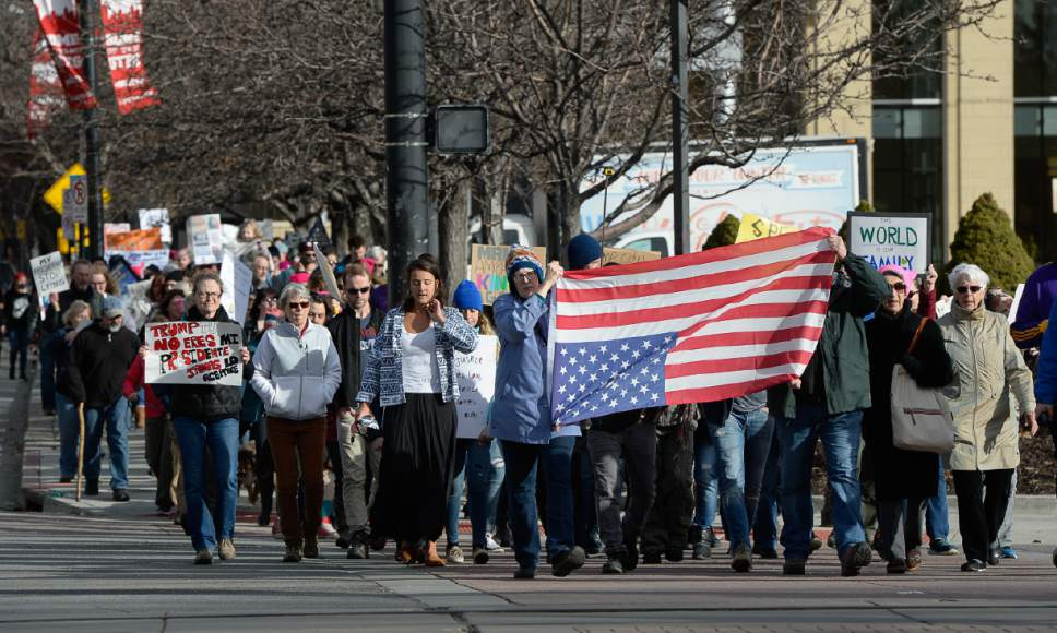 Francisco Kjolseth | The Salt Lake Tribune Protesters take to the streets on President's Day in Salt Lake City, Monday, Feb. 20, 2017, to protest President Donald Trump.