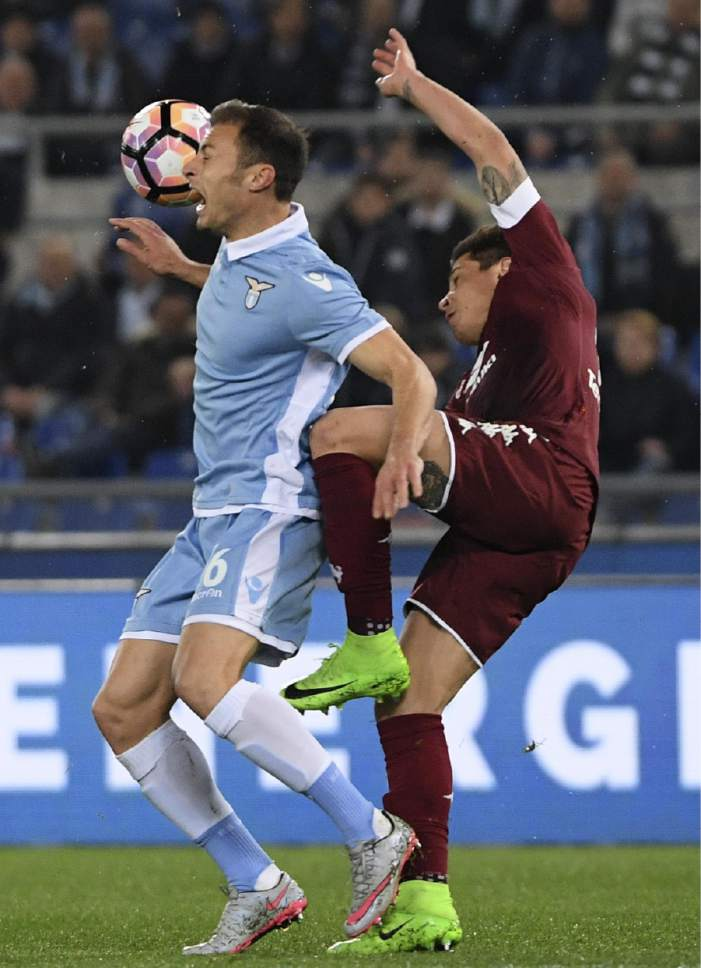 Lazio's Stefan Radu, left, and Torino's Juan Iturbe vie for the ball during the Italian Serie A soccer match between Lazio and Torino at the Olympic stadium in Rome, Monday, March 13, 2017. (Maurizio Brambatti/ANSA via AP)
