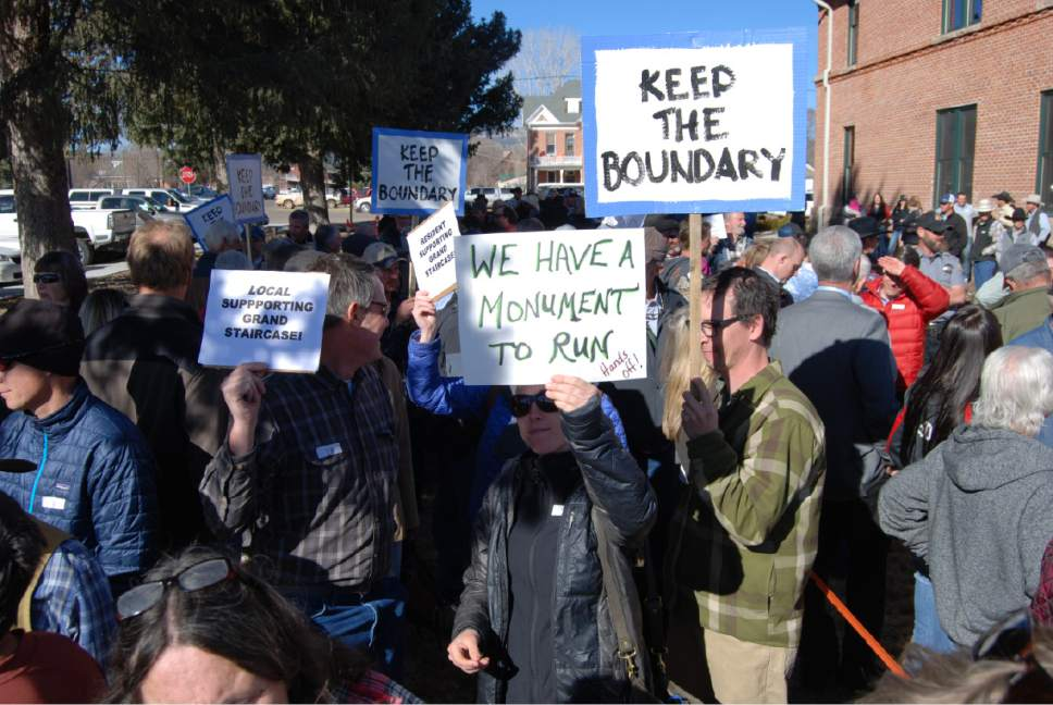 Brian Maffly     The Salt Lake Tribune  At least 200 Garfield County residents gathered outside county offices in Panguitch Monday to speak for and against a resolution calling for the downsizing of the Grand Staircase-Escalante National Monument.