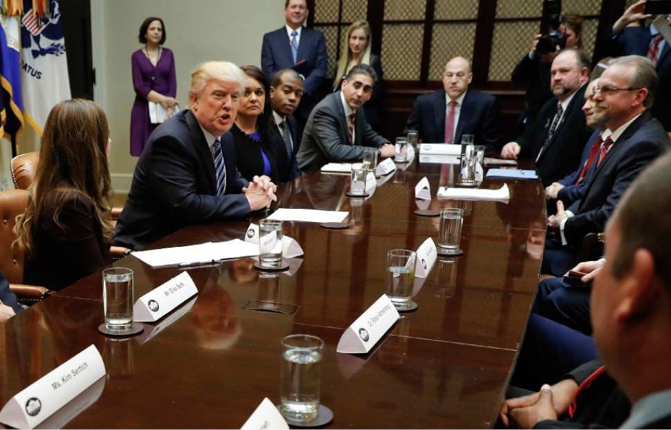 Stan Summers, top right, of Utah attends a meeting on healthcare in the Roosevelt Room of the White House in Washington, Monday, March 13, 2017. (AP Photo/Pablo Martinez Monsivais)
