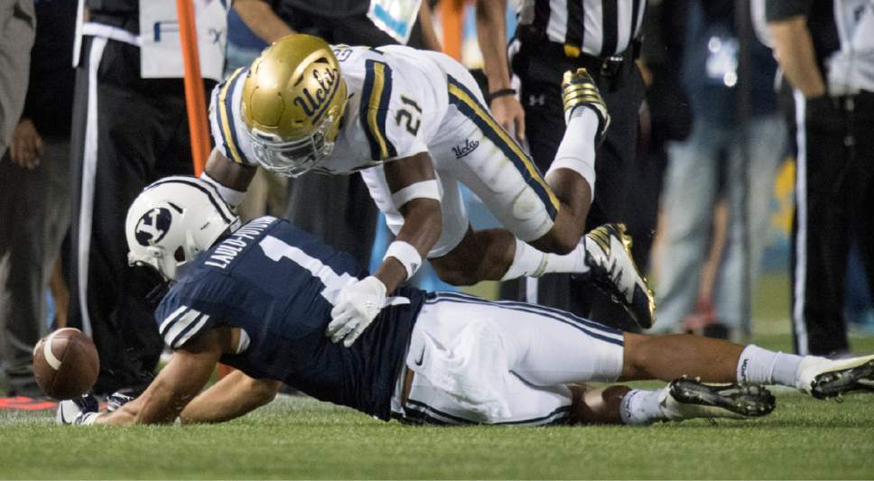 Rick Egan  |  The Salt Lake Tribune  UCLA Bruins defensive back Tahaan Goodman (21) breaks up a pass intended for Brigham Young Cougars wide receiver Moroni Laulu-Pututau (1), in football action, BYU vs, UCLA, at Lavell Edwards Stadium, Saturday, September 17, 2016.