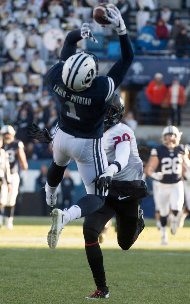 Rick Egan  |  The Salt Lake Tribune  Brigham Young Cougars wide receiver Moroni Laulu-Pututau (1) grabs a pass as Fresno State Bulldogs defensive back Malcolm Washington (20) defends, in football action, BYU vs. The Fresno Bulldogs, at Lavell Edwards stadium, Tuesday, November 21, 2015.