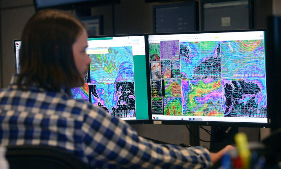 Al Hartmann  |  The Salt Lake Tribune Glen Merill, meteorologist forecaster for the Nationl Weather Service studies local and national forecast models in Salt Lake City on Tuesday. Temperatures for the week will be at least 20 degrees warmer than normal for this time of year setting up the possiblity of flooding.