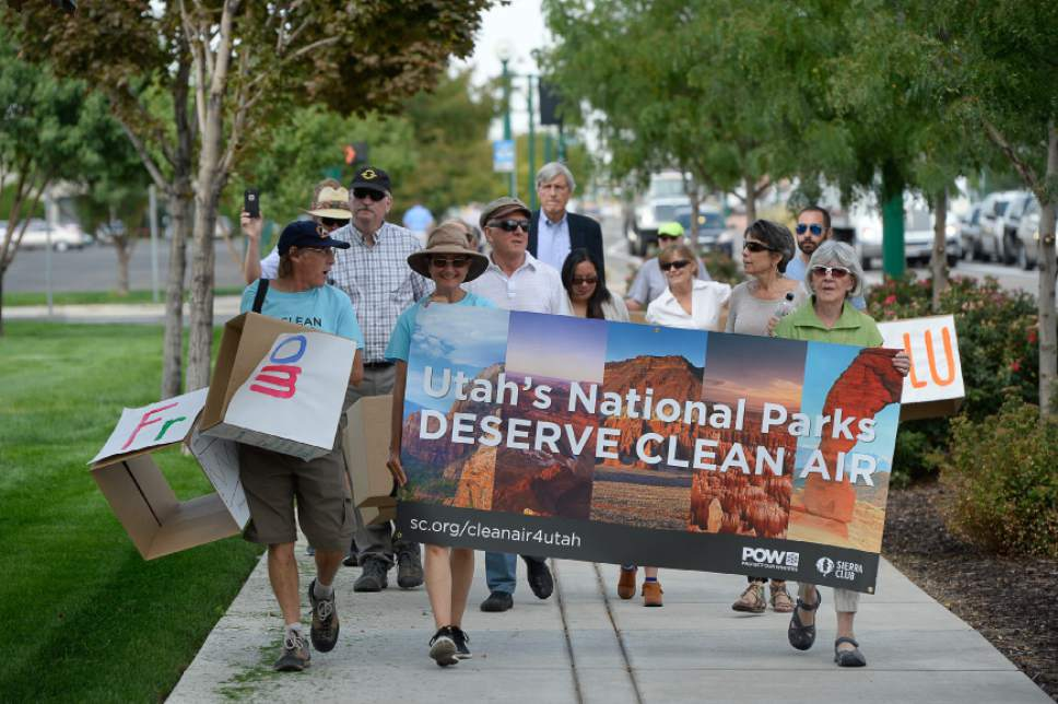 Francisco Kjolseth | The Salt Lake Tribune Clean air, public health and national park advocates march in support of the Environmental Protection Agencyís (EPA) recently approved plan to reduce coal pollution in beloved national parks such as Arches, Canyonlands and Zion. The group marched to Rocky Mountain Power headquarters in Salt Lake City on Tuesday, Aug. 23, 2016,  to deliver a petition with over 43,000 signatures asking the utility not to sue to stop the EPAís plan.