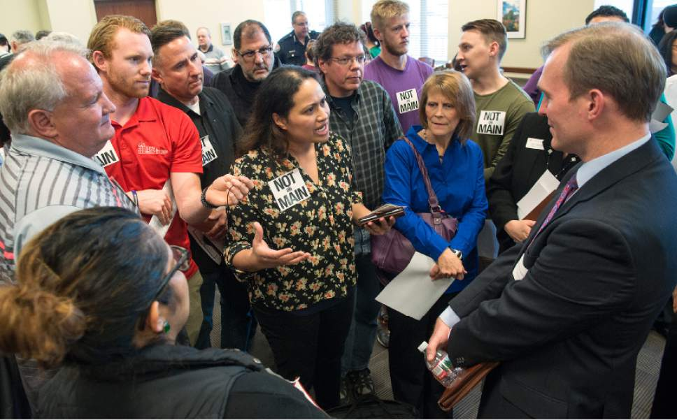 Leah Hogsten  |  The Salt Lake Tribune Umu Tafisi (center) expresses her concerns of the proposed shelter site at 3091 South Main Street and its proximity to the state liquor store to Salt Lake County Mayor Ben McAdams. Hundreds of concerned citizens packed the state Capitol's Senate Building cafeteria Tuesday, March 14, 2017 during one of three  scheduled opportunities for the public to give feedback on possible shelter sites to Salt Lake County Mayor Ben McAdams and county staff.