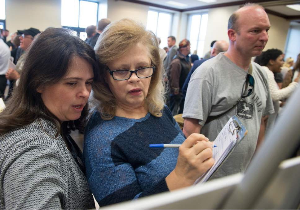 Leah Hogsten  |  The Salt Lake Tribune l-r Sisters Darleen Stephens and Nataleen Johnson study the map of the proposed shelter site at 1144 West and 3300 South while writing down why the site selection is problematic on a feedback form. Hundreds of concerned citizens packed the state Capitol's Senate Building cafeteria Tuesday, March 14, 2017 during one of three  scheduled opportunities for the public to give feedback on possible shelter sites to Salt Lake County Mayor Ben McAdams and county staff.