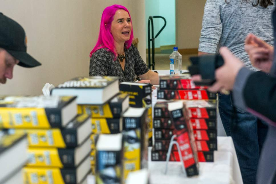Chris Detrick  |  The Salt Lake Tribune Author Laini Taylor signs books during the Utah Book Festival at the Salt Lake City Library in 2014. The annual festival, which takes place in events across the state, is supported by grant funds from the National Endowment for the Humanities.