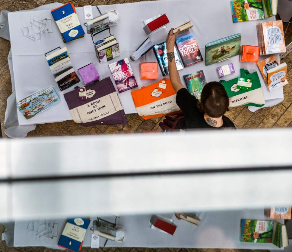 Chris Detrick  |  The Salt Lake Tribune People browse books for sale during the Utah Book Festival at the Salt Lake City Library in 2014. The annual festival, which takes place in events across the state, is supported by grant funds from the National Endowment for the Humanities.
