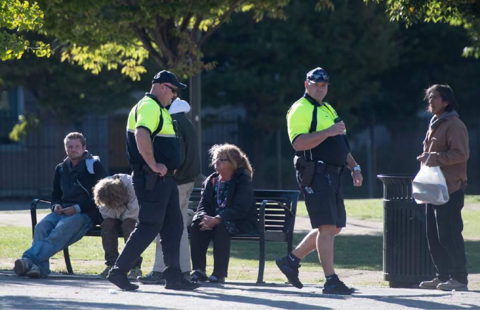 Rick Egan  |  The Salt Lake Tribune  Salt Lake City police make their rounds amount the homeless people in the Rio Grande neighborhood. Thursday, October 6, 2016.