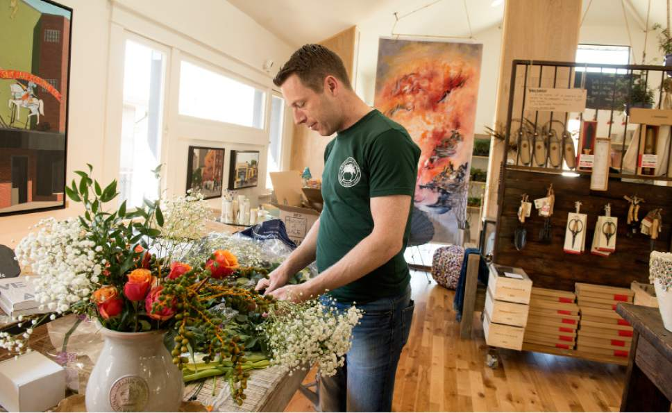 "Leah Hogsten  |  The Salt Lake Tribune Irish horticulturist Peter Donegan, who hosts the internationally recognized podcast called ""Sodshow"" will be teaching classes at Tyyme & Place this weekend. Donegan arranges flowers in the colors of Ireland, orange, green and white. Melinda Meservy, owner of Thyme and Place gardens shop had 250 ""real"" shamrocks from Ireland shipped to her store as part of a week-long gardening series taking place over St. Patrick's Day weekend."