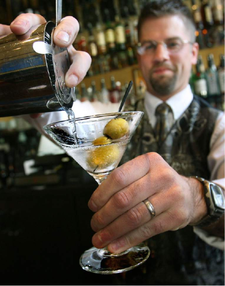 Scott Sommerdorf  |  Tribune file photo Salt Lake City bartender Adam Takoch pours a vodka martini.