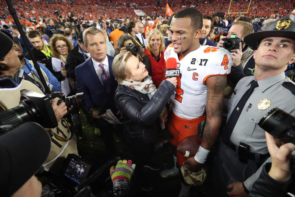 Allen Kee |  ESPN Images Holly Rowe interviews Clemson quarterback Deshaun Watson after the Tigers won the national championship Jan. 9 in Tampa, Fla.