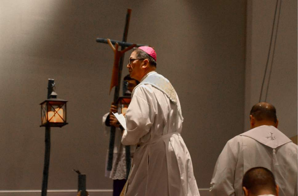 Mike Stack  |  for The Salt Lake Tribune  Bishop Oscar Solis approaches the altar.