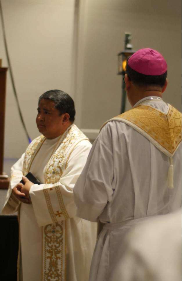 Mike Stack  |  for The Salt Lake Tribune  The Reverend Albert Avenido celebrates Mass with Bishop Oscar Solis.