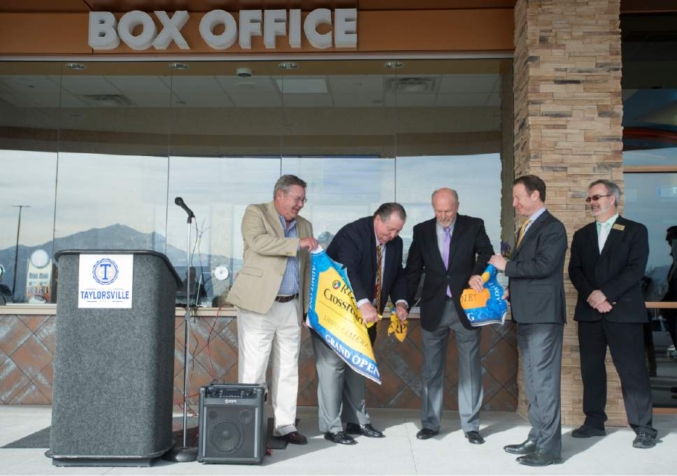 Rick Egan  |  The Salt Lake Tribune  Taylorsville Mayor Larry Johnson and William J Stone, with S Squared Development, tear the ceremonial ticket, at the grand opening of the  Regal Crossroads 14 on Thursday, March 16, 2017.