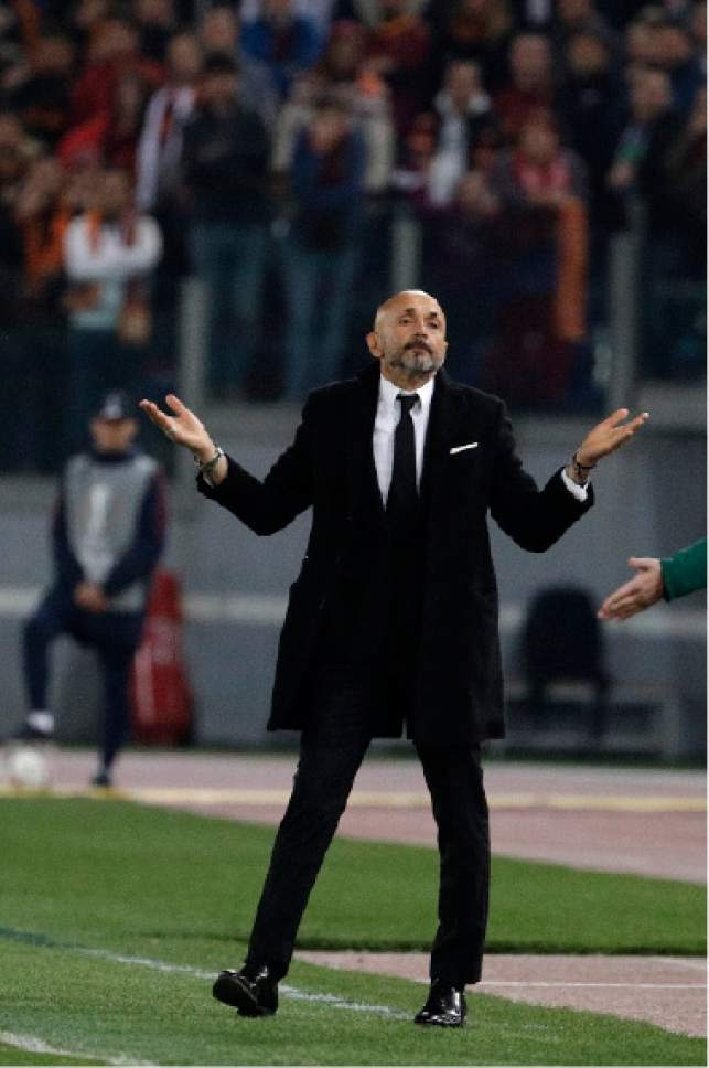 Roma head coach Luciano Spalletti gestures during the Europa League round of 16 second leg soccer match between Roma and Lyon, in Rome's Olympic stadium, Thursday, March 16, 2017. (AP Photo/Andrew Medichini)