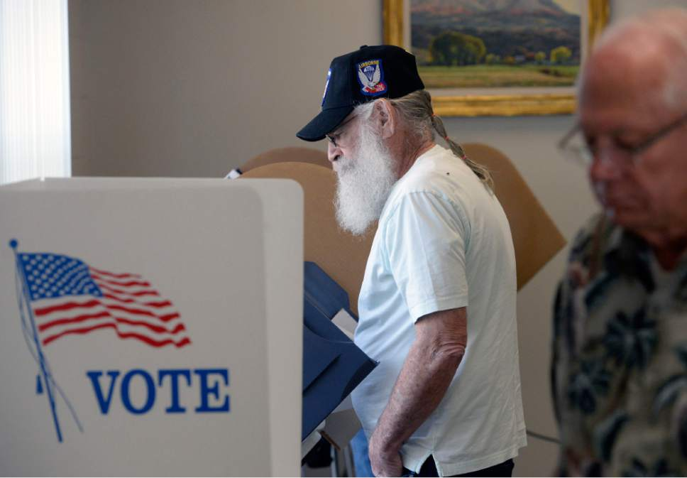 Al Hartmann     The Salt Lake Tribune Army veteran Dail Sullivan is first in line to vote early at the River Bend Senior Center in Salt Lake City  Tuesday October 21, 2014.  Voting was brisk at the poll which opened at 10 a.m. The early vote started Tuesday and continues through Halloween.