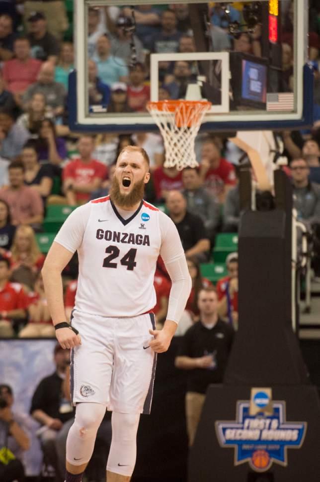 Chris Detrick  |  The Salt Lake Tribune  Gonzaga Bulldogs center Przemek Karnowski (24) celebrates as they take on Northwestern in the NCAA tournament in Salt Lake City on Saturday, March 18, 2017.
