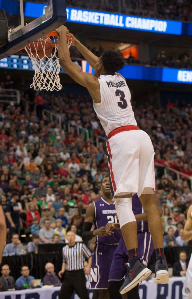 Chris Detrick  |  The Salt Lake Tribune  Gonzaga Bulldogs forward Johnathan Williams (3) dunks the ball against Northwestern as the teams face off in the NCAA tournament in Salt Lake City on Saturday, March 18, 2017.