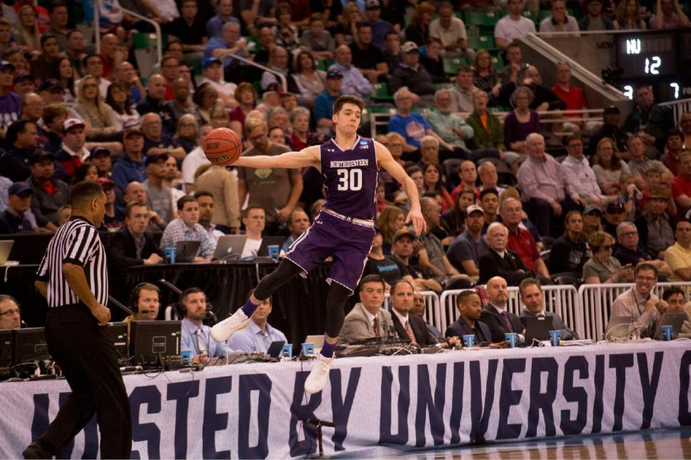 Chris Detrick  |  The Salt Lake Tribune  Northwestern Wildcats guard Bryant McIntosh (30) keeps the ball inbounds against Gonzaga as the teams face off in the NCAA tournament in Salt Lake City on Saturday, March 18, 2017.