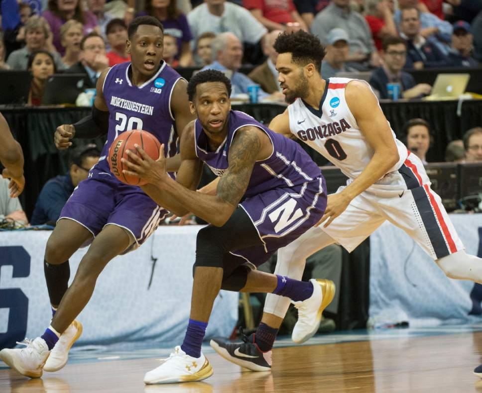 Chris Detrick  |  The Salt Lake Tribune  Northwestern Wildcats forward Vic Law (4) is guarded by Gonzaga Bulldogs guard Silas Melson (0) as the teams face off in the NCAA tournament in Salt Lake City on Saturday, March 18, 2017.