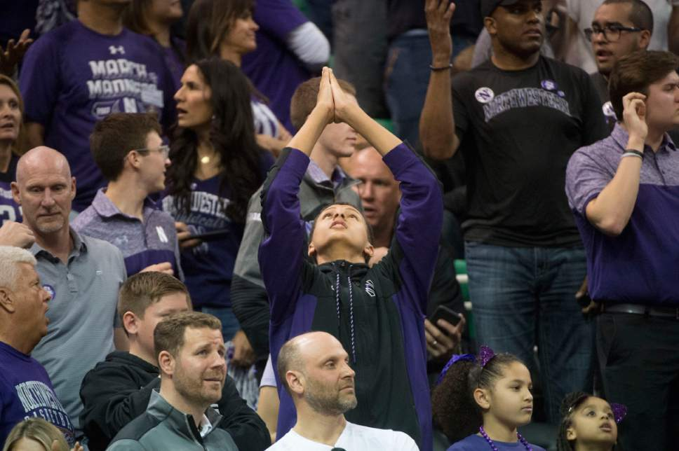 Chris Detrick  |  The Salt Lake Tribune  A Northwestern fan appears to be praying as Northwestern faces Gonzaga in the NCAA tournament in Salt Lake City on Saturday, March 18, 2017.