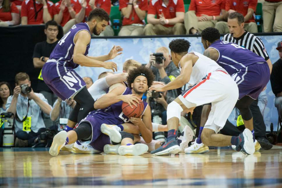 Chris Detrick  |  The Salt Lake Tribune  Northwestern Wildcats center Barret Benson (25) grabs the ball during a scramble as they face Gonzaga in the NCAA tournament in Salt Lake City on Saturday, March 18, 2017.