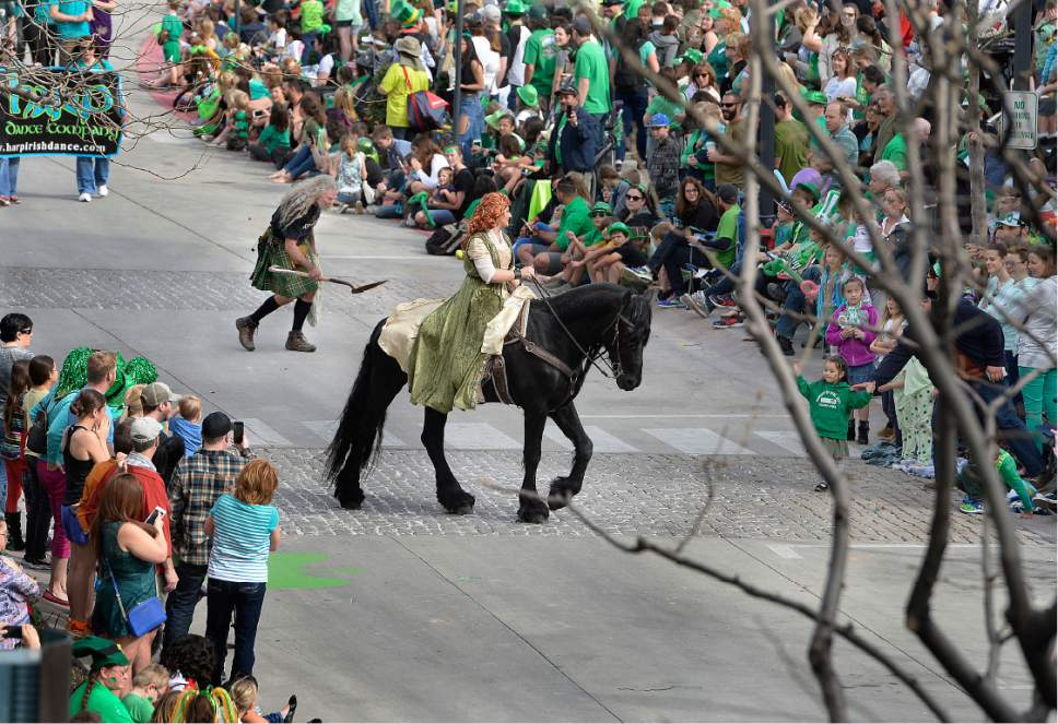 Scott Sommerdorf | The Salt Lake Tribune A horse and rider with a dedicated scooper during the 39th annual St. Patrick's Parade makes it's way through the Gateway shopping center, Saturday, March 18, 2017.
