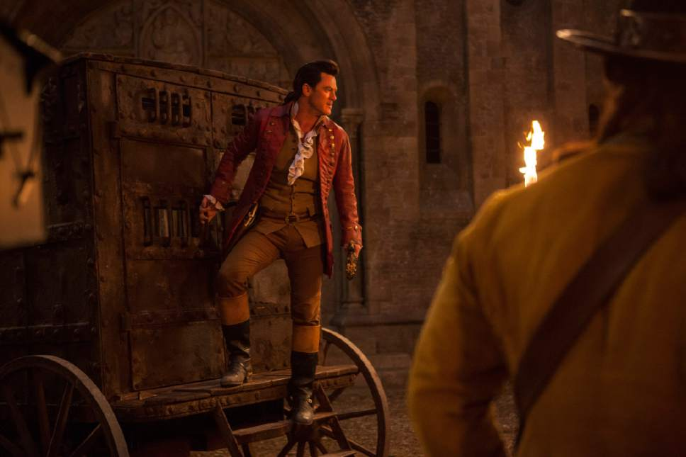 "This image released by Disney shows Luke Evans as Gaston in ""Beauty and the Beast."" (Laurie Sparham/Disney via AP)"