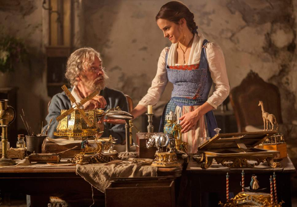 "This image released by Disney shows Emma Watson as Belle, right, and Kevin Kline as Maurice in a scene from ""Beauty and the Beast."" (Laurie Sparham/Disney via AP)"