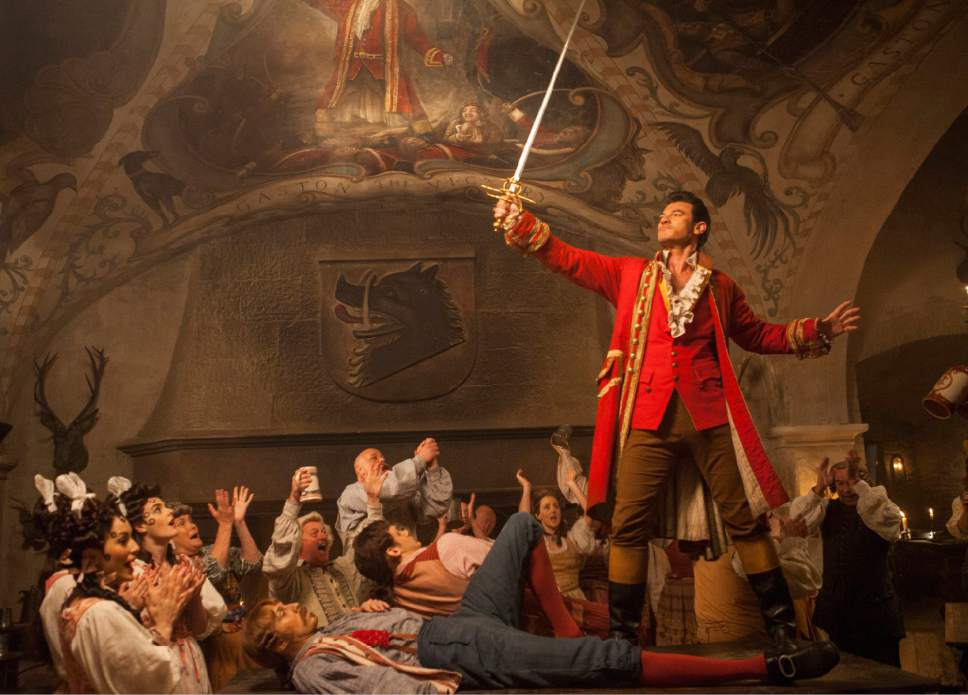 "This image released by Disney shows Luke Evans in a scene from ""Beauty and the Beast."" (Laurie Sparham/Disney via AP)"