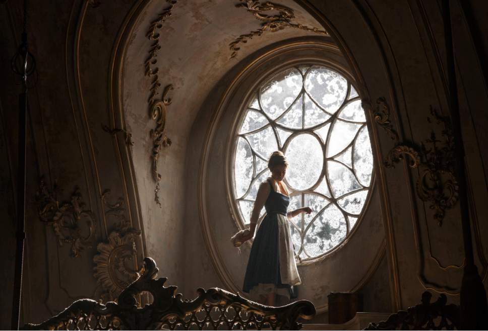"""This image released by Disney shows Emma Watson as Belle in a live-action adaptation of the animated classic """"Beauty and the Beast."""" (Laurie Sparham/Disney via AP)"""
