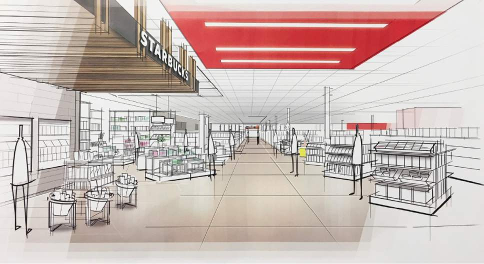 """This image provided by Target Corp. shows a rendering of an area of a redesigned Target store, featuring an """"inspiration"""" entrance, meant to inspire people to explore. On Monday, March 20, 2017, Target announced an ambitious redesign of its stores, aimed at helping people who need to dash in for essentials to get out quickly while encouraging those who want to wander the aisles to linger. The new layout will feature a separate entrance for shoppers who can use 10-minute parking to pick up an online order or some essentials. It will also have curved, more circular center aisles, instead of squared-off lines, meant to inspire people to explore. (Target Corp. via AP)"""