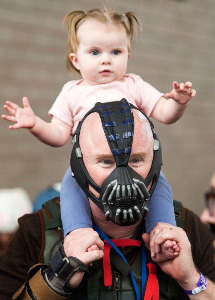 "Rick Egan  |  The Salt Lake Tribune  Layne Nielson, Logan as ""Bane"" with his grand daughter Harley Shumway, at the 4th annual FanX,  at The Salt Palace Convention Center, Friday, March 17, 2017."