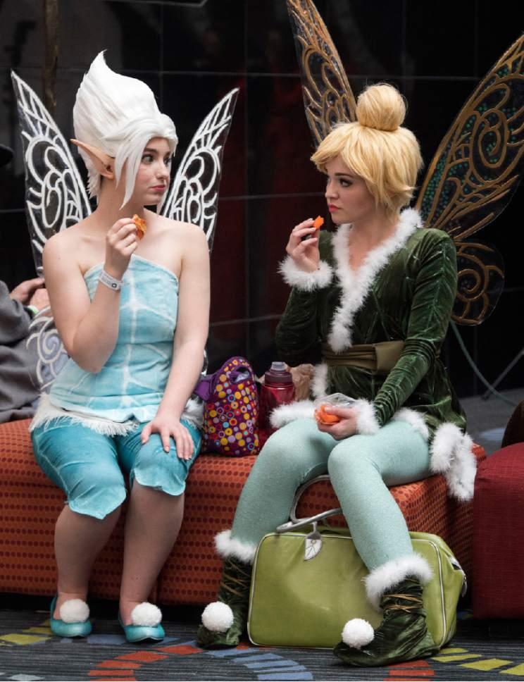 "Rick Egan  |  The Salt Lake Tribune Alex Hale, and Emily Lane, Layton, as ""Periwinkle and Tinkerbell"" stop to have a snack, at the 4th annual FanX,  at The Salt Palace Convention Center, Friday, March 17, 2017."