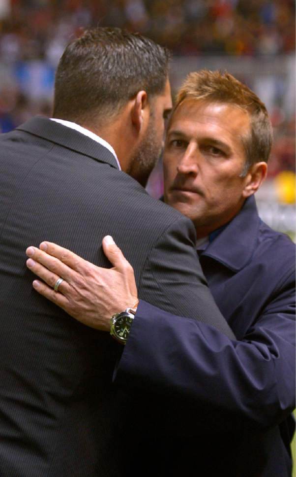 Former colleagues Real Salt Lake head coach Jeff Cassar and New York City FC head coach Jason Kreis share a hug after an MLS soccer game Saturday, May 23, 2015, in Sandy, Utah. (Leah Hogsten/The Salt Lake Tribune via AP) DESERET NEWS OUT; LOCAL TELEVISION OUT; MAGS OUT