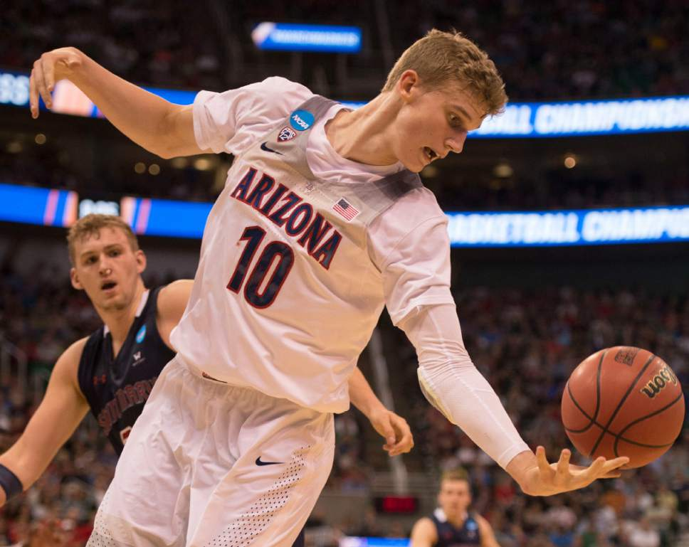 Trent Nelson  |  The Salt Lake Tribune  Arizona Wildcats forward Lauri Markkanen (10) tries to get control of a rebound while facing St. Mary's in the NCAA tournament in Salt Lake City on Saturday, March 18, 2017.