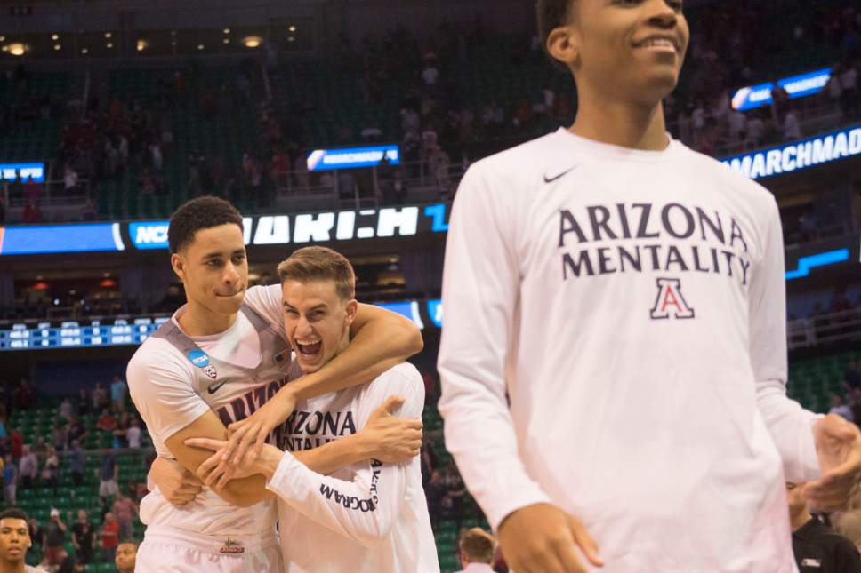 Chris Detrick  |  The Salt Lake Tribune  Arizona Wildcats center Chance Comanche (21) hugs teammate Arizona Wildcats forward Jake DesJardins (55) after they beat St. Mary's in the NCAA tournament in Salt Lake City on Saturday, March 18, 2017.