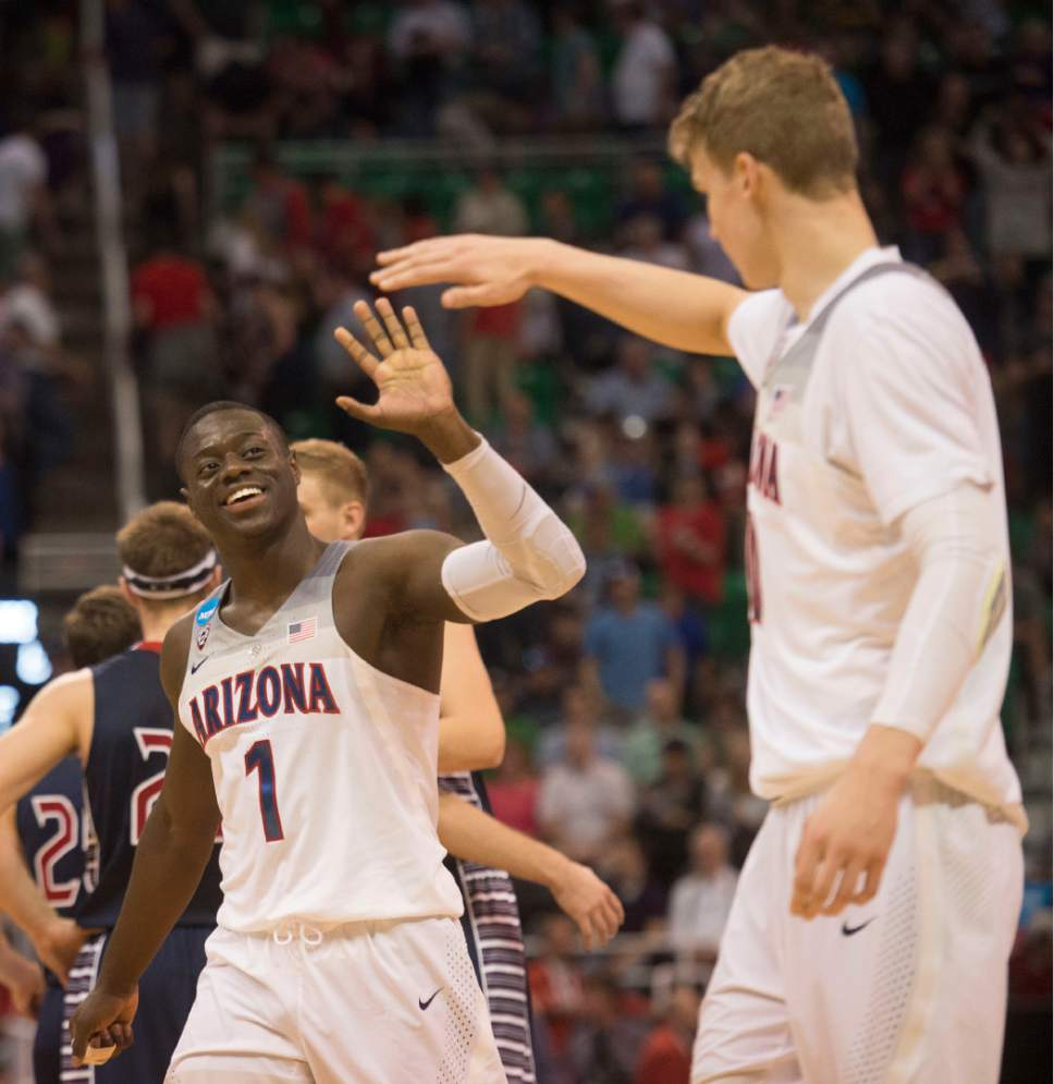 Chris Detrick  |  The Salt Lake Tribune  Arizona Wildcats guard Rawle Alkins (1) high fives Arizona Wildcats forward Lauri Markkanen (10) after they beat St. Mary's in the NCAA tournament in Salt Lake City on Saturday, March 18, 2017.