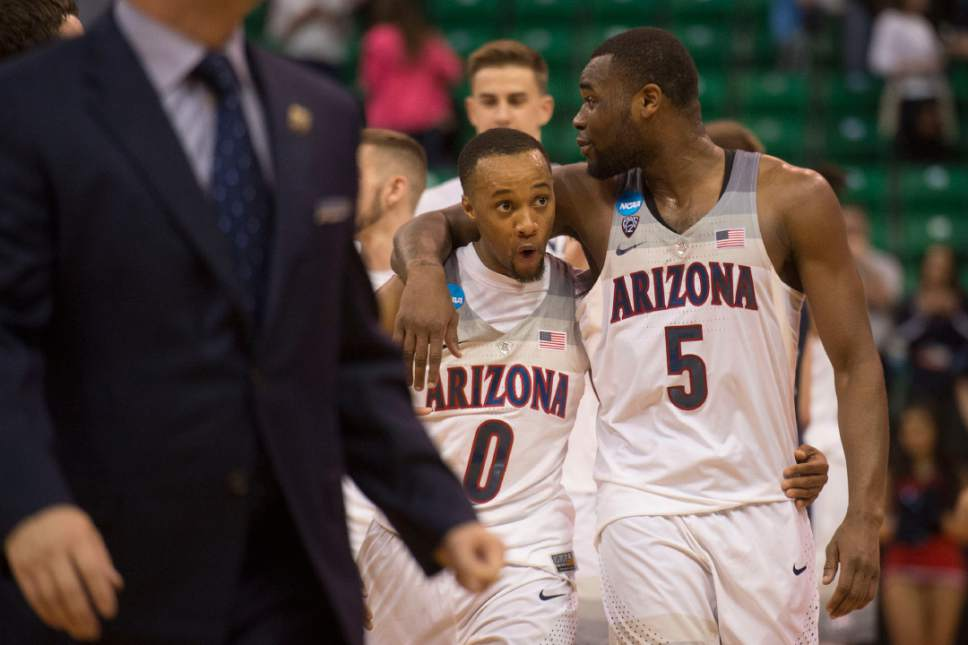 Chris Detrick  |  The Salt Lake Tribune  Arizona Wildcats guard Parker Jackson-Cartwright (0) and Arizona Wildcats guard Kadeem Allen (5) leave the court after beating St. Mary's in the NCAA tournament in Salt Lake City on Saturday, March 18, 2017.